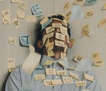 A man covered in sticky notes